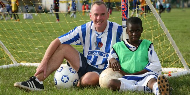 Norman Cook, with  Fousseini Cisse (14) an orphan from SOS orphange. Contact (07967 353 220)